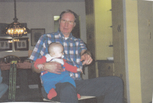Connor on Poppa's knee